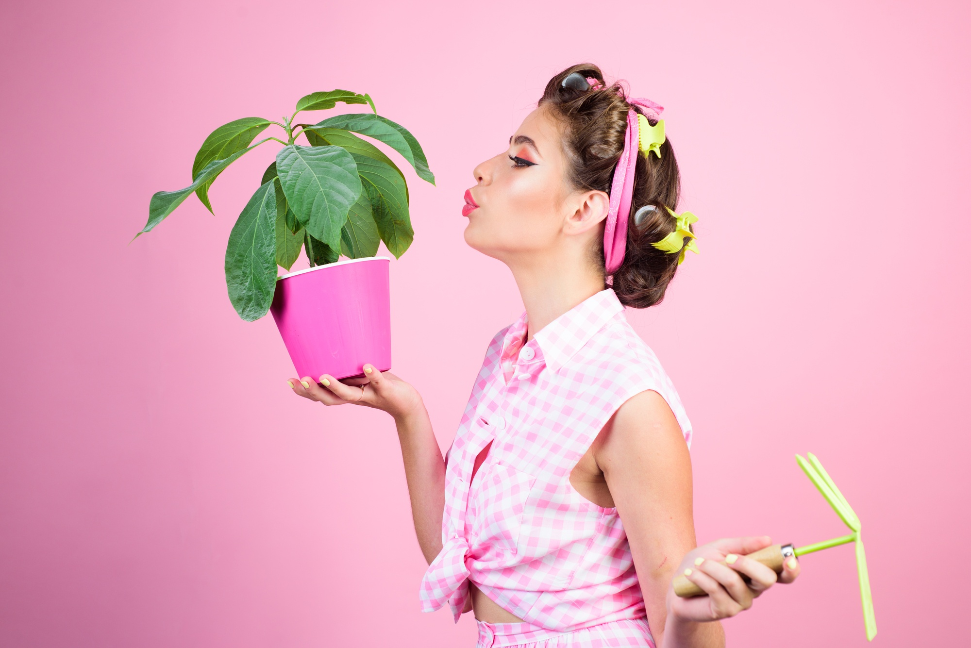 retro woman growing plants. Garden. pinup girl with fashion hair. greenhouse worker or gardener. spring. pin up woman with trendy makeup. pretty girl in vintage style. Woman with potted plant